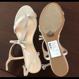 Embellished T strap sandals.
